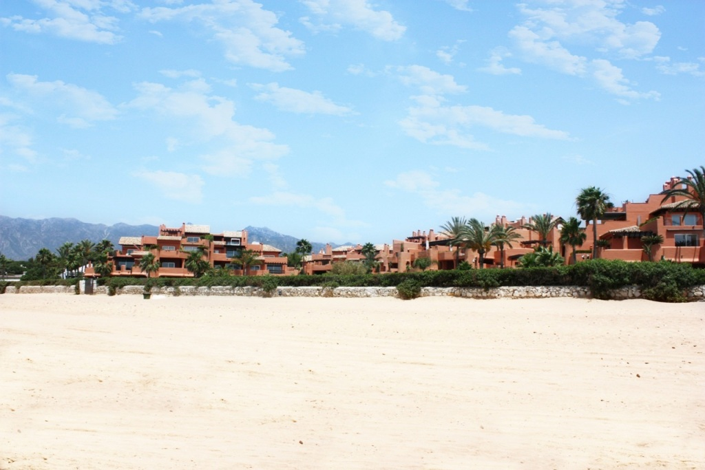 Sand beach at Beachfront Apartment in Los Monteros, Marbella