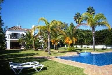 pool and gardens of magnificent villa in guadalmina baja