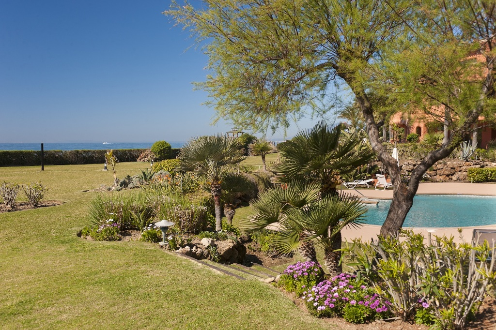landscaped gardens at Beachfront Apartment in Los Monteros, Marbella