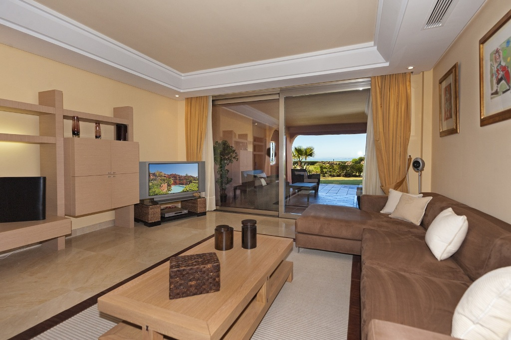 living room & terrace at Beachfront Apartment in Los Monteros, Marbella